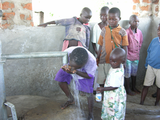 Children drinking clean water for first time