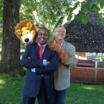 From right: DOC the Clown, aka David Polley, WCCM Vice President of Africa and Asia Jaideep Jesudoss, and Larry the Lion puppet that was stayed with the ministers of Kenya when the WCCM team left.