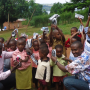 Children in Kigali, Rwanda show their new shoes donated by the children of Bangalore, India.