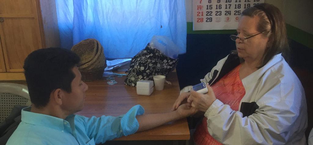 WCCM Partner and American Registered Nurse Stephanie Leake takes blood pressure reading